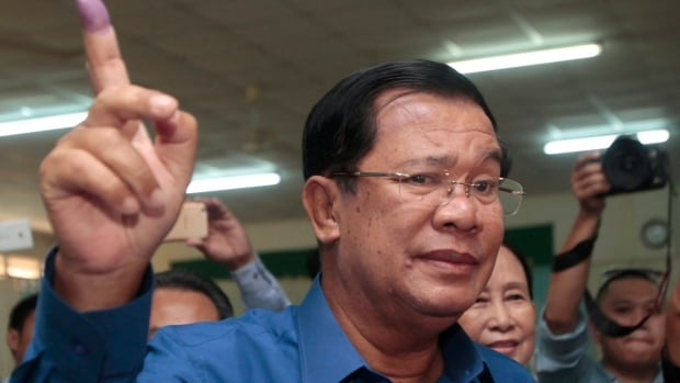 Cambodian Prime Minister Hun Sen shows off his inked finger after voting in local elections in Kandal province, southeast of Phnom Penh. Hun Sen has been leader of the nation dating back to the 1980s.