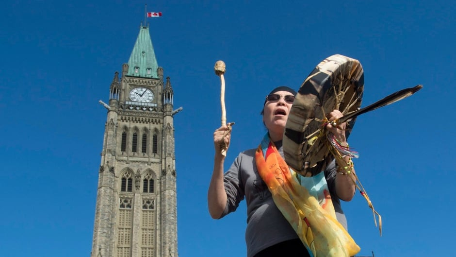 Chief Marcia Brown Martel, the lead plaintiff in an Ontario class action lawsuit related to the Sixties Scoop, drums out of Centre Block on Parliament Hill on Friday.