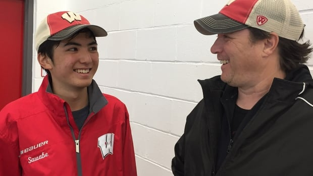 Westchester (County) Express triple-A minor Bantam head coach Scott Sanders, right, believes 13-year-old Japanese defenceman Yuji Sawabe, left, who could barely skate five years ago, has a good chance to play U.S. Division I college hockey.