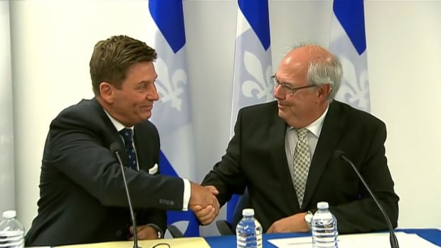 Quebec Treasury Board President Pierre Moreau and FMOQ president, Dr. Louis Godin, announced the sealing of a deal that will see family doctors' salaries go up 1.8 per cent annually over the next eight years.