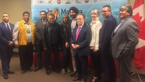 Participants at Friday's event in Thunder Bay, Ont, announcing the intent to bring high-speed internet to five fly-in First Nations communities.