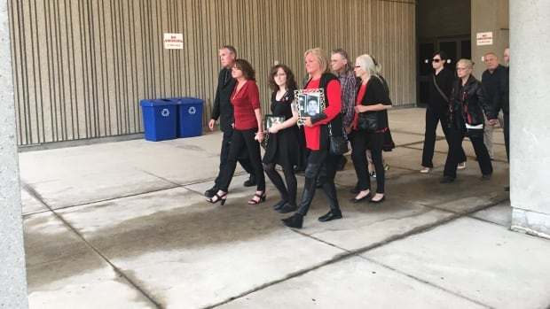 Adam Kargus' family walks out of court Friday, following the sentencing of his killer Anthony George. George was Kargus' cellmate when he beat the 29-year-old man to death in an alcohol and drug-fuelled frenzy.