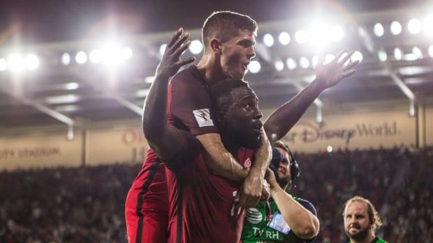 Christian Pulisic, top, and Jozy Altidore celebrate during the U.S.'s 4-0 win over Panama in World Cup qualifying on Friday.