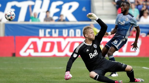 Vancouver Whitecaps goalkeeper David Ousted has the ball fly over his head for New York City's first goal in their 3-0 victory Saturday.