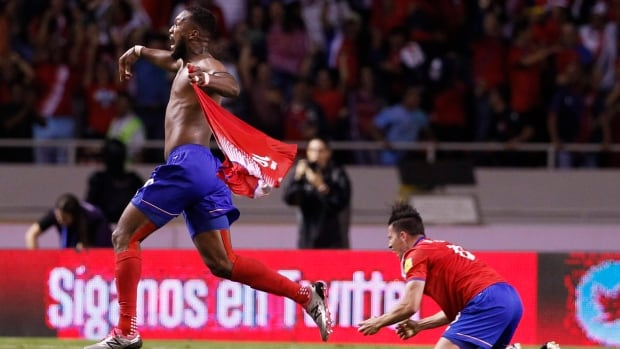 Costa Rica's Kendall Waston, left, celebrates after scoring his team's equalizer against Honduras, during their World Cup qualifying soccer match.