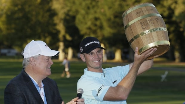 Brendan Steele holds up his trophy on the 18th green of the Silverado Resort North Course after winning the Safeway Open.