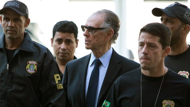 President of the Brazilian Olympic Committee Carlos Arthur Nuzman, centre, is escorted by police following his arrest in Rio de Janeiro in October. Nuzman is accused of taking part in an alleged vote-buying scheme to secure the Rio 2016 Olympics.