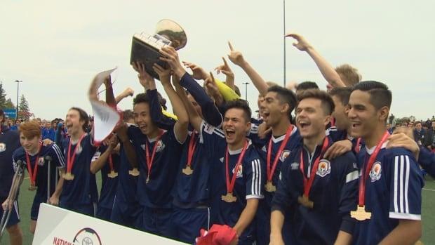 The Bonivital SC under 17 boys' team celebrates a hard fought gold medal win over Quebec.