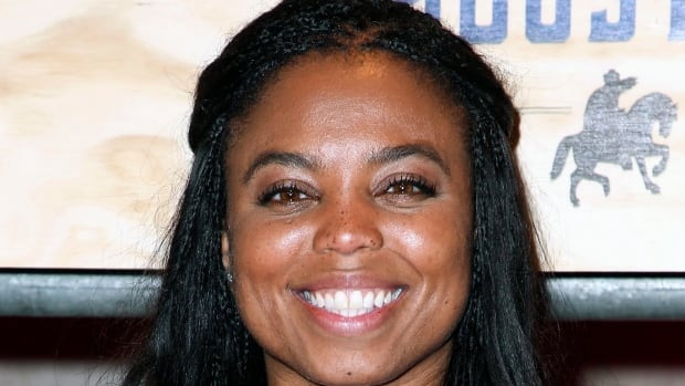 ESPN anchor Jemele Hill has been suspended by the network for two weeks for making political statements on social media.