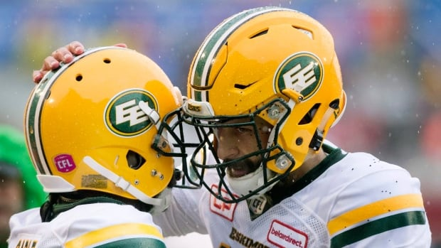 Edmonton Eskimos quarterback Mike Reilly, right, celebrates with teammate C.J. Gable following a touchdown during the first half.