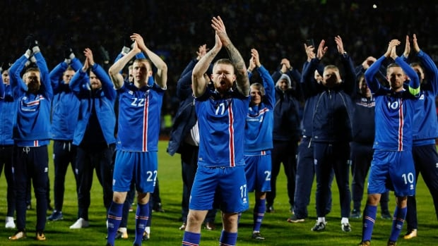 Iceland's captain Aron Gunnarsson celebrates with teammates at the end of the World Cup Group I qualifying soccer match.