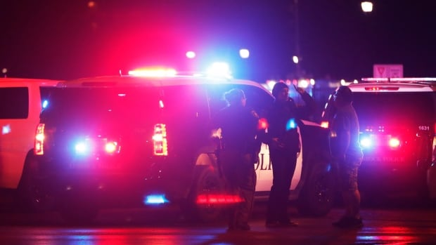 Emergency personnel stage near Texas Tech University campus in Lubbock, Texas, after police apprehended a 19-year-old student accused of fatally shooting a university police officer.