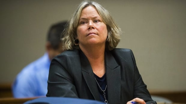 Dr. Eden Wells, chief medical executive of the Michigan Department of Health and Human Services, appears in court for the first day of her preliminary examination on Monday, Oct. 9, 2017, in District Court in Flint, Mich. The hearing was postponed when prosecutors said they would add a charge of involuntary manslaughter.