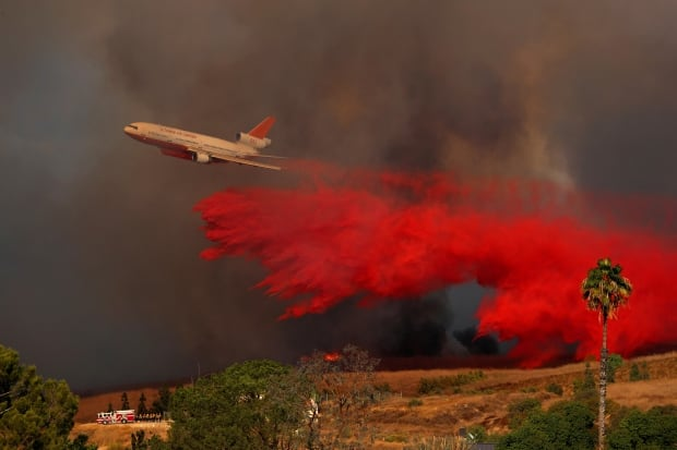CALIFORNIA FIRE DC-10 aircraft drops fire retardant on wildfire