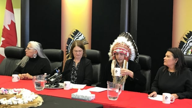 Indigenous Services Minister Jane Philpott, second from left, and AMC Grand Chief Arlen Dumas, second from right, announced money for a family advocacy centre on Tuesday. On Wednesday, they'll be at the grand opening of the Manitoba First Nations School System.