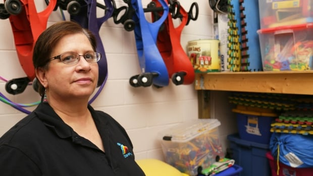 Brenda Reisch, executive director of Children at Risk, stands next to supplies for her organization's annual summer camp, Camp Kaleidoscope. She said camp fees will have to 'increase astronomically' as a result of the proposed minimum wage hike in Ontario.