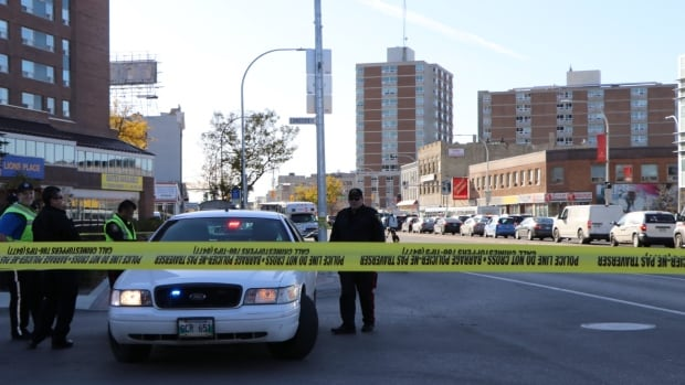 Police block eastbound lanes of Portage Avenue at Sherbrook Street on Tuesday afternoon.