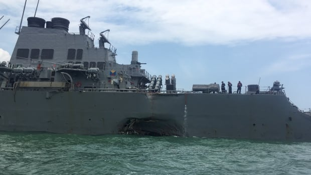 The guided-missile destroyer USS John S. McCain is seen after a collision with an oil tanker off Singapore in August.