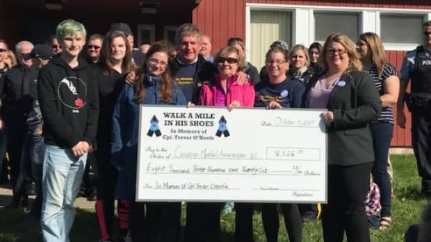 Family members of RCMP Cpl. Trevor O'Keefe were in Clarenville on Wednesday for a walk to raise money for the Canadian Mental Health Association.