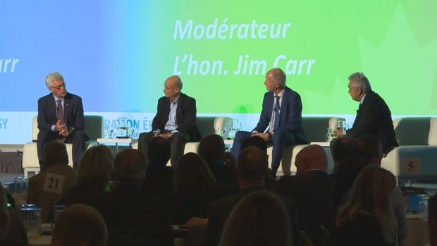 Natural Resources Minister Jim Carr, far left, leads a Q&A session in Winnipeg with, right to left: Dr. Fatih Birol, International Energy Agency; Rainer Bakke, German Ministry for Economic Affairs and Energy; and Jeremy Rifkin, Foundation on Economic Trends.