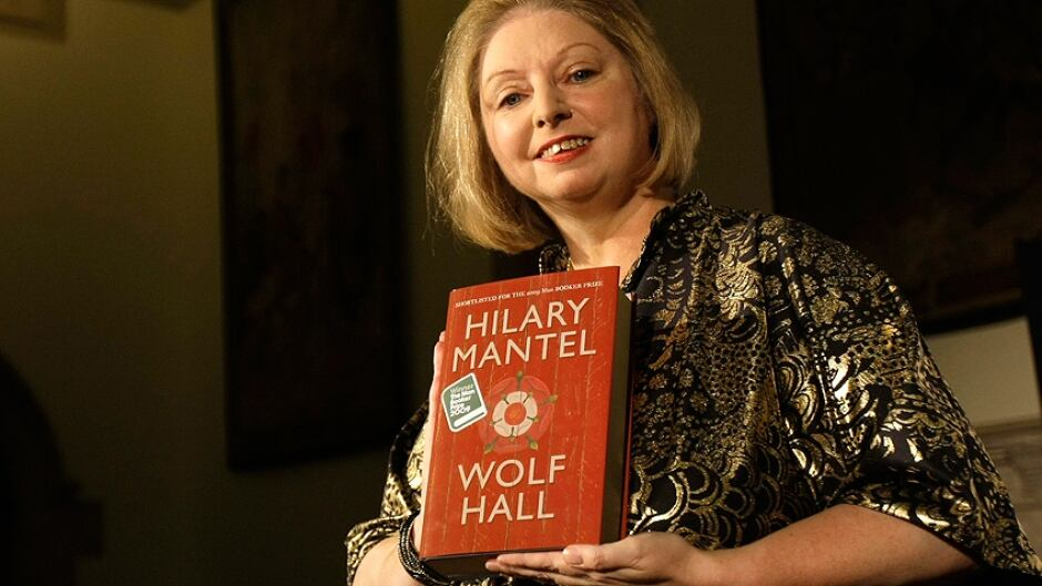 Winner of the 2009 Booker Prize for fiction Hilary Mantel with her book  ' Wolf Hall ' poses for photographers following the announcement in central London, Tuesday. Oct. 6, 2009 .