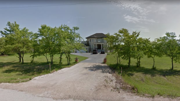 A resident of Four Mile Road doesn't want the owner of this 3,000-square-foot St. Anne's Road home to have the right to park a semi-trailer tractor.