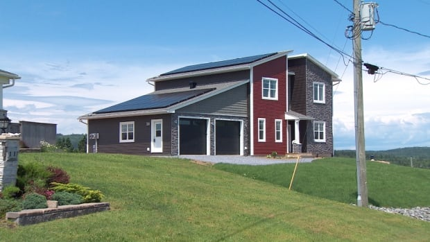 Installing solar panels on New Brunswick houses is not common but a study says NB Power should encourage more of it.