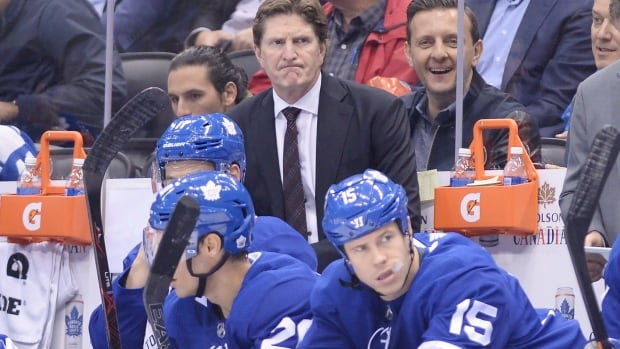 Toronto Maple Leafs coach Mike Babcock, top, scowls during his team's 5-2 loss to the New Jersey Devils on Wednesday.