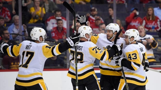 Pittsburgh Penguins defenceman Kris Letang (58) celebrates his first goal of the season with Conor Sheary (43), Patric Hornqvist (72) and Bryan Rust (17) during the first period of Wednesday's 3-2 victory over Washington.