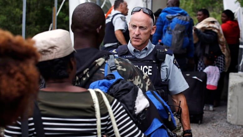 Critics question why Canada's border officers need bulletproof vests to work with migrants