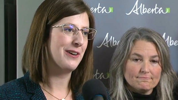 Jade Mahon, a vice-president at Partners Development Group, right, listens as Service Alberta Minister Stephanie McLean announces new regulations concerning condominiums on Thursday in Calgary.