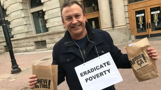 Peter Gilmer helped hand out apples and pamphlets on Thursday as part of the Chew On This anti-poverty campaign. He said the government will begin to act if people demand change.
