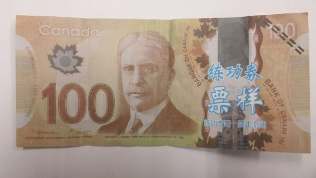 RCMP say the fake $100 bills are paper not plastic, like real Canadian money, which are a polymer.