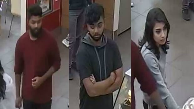 Police have released this security camera footage of three people wanted in an assault and arson investigation.