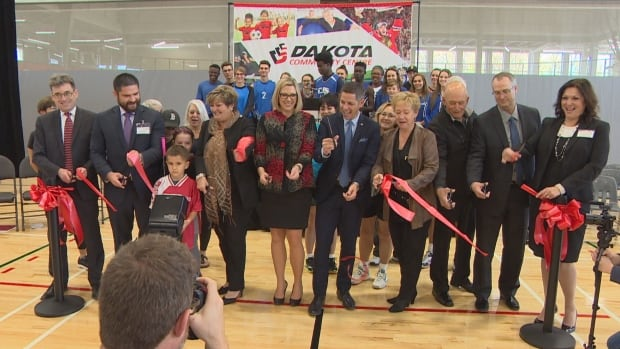 Dignitaries including Winnipeg mayor Brian Bowman and Manitoba Sustainable Development Minister Rochelle Squires cut the ribbon on Dakota Community Centre's new $20.5-million fieldhouse Thursday.