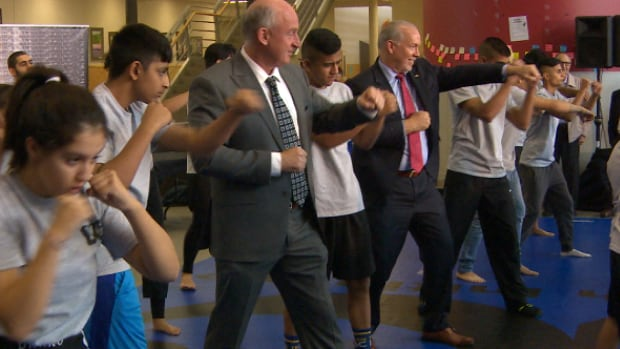 B.C. Public Safety Minister Mike Farnworth and Premier John Horgan work out with students at Princess Margaret Secondary School in Surrey, following an anti-gang funding announcement.