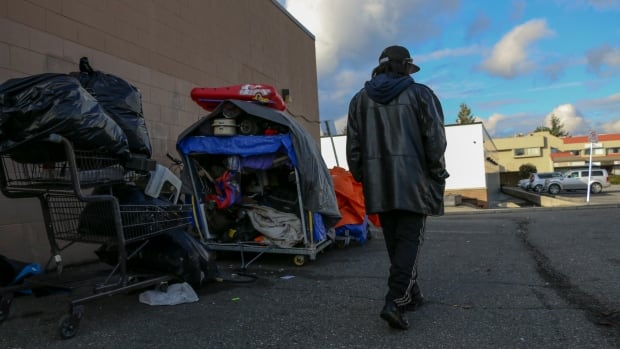 Clarence James walks in the alleyway next to Positive Living Fraser Valley, a non-profit organization in Abbotsford, B.C.