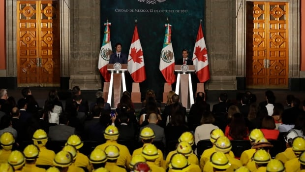 Prime Minister Justin Trudeau and Mexican President Enrique Pena Nieto take questions in front of an audience that includes earthquake rescue workers, at the National Palace in Mexico City, Thursday. Trudeau is in Mexico for a two-day official visit.