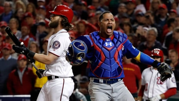 Catcher Willson Contreras, right, celebrates Bryce Harper's ninth-inning strikeout to seal the Chicago Cubs' series-ending 9-8 win over the Washington Nationals on Thursday.