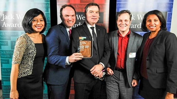 CBC Vancouver's Michelle Eliot, Richard Zussman, Stephen Quinn, Justin McElroy and Theresa Duvall pose with their Jack Webster Award.