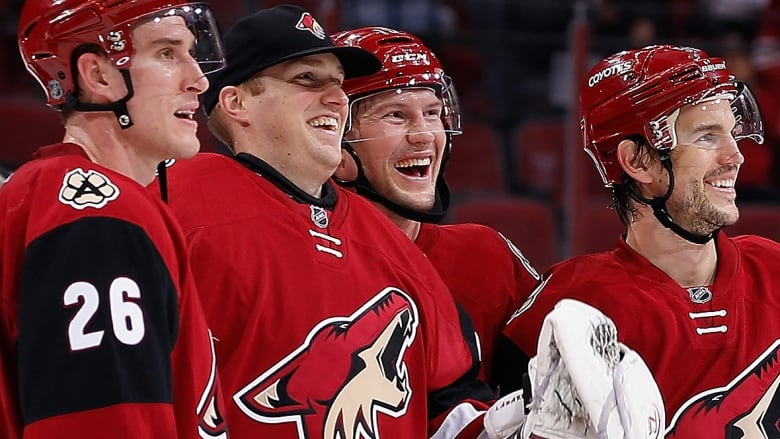 ee825f248 Nate Schoenfeld, second from left, celebrates a 6-2 Coyotes win over  Montreal last season with the now-retired Shane Doan, second from right.