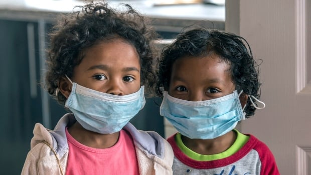 In this Oct. 3 photo, children wear face masks at a school in Antananarivo, Madagascar. Dozens have died from a plague outbreak in the island nation.