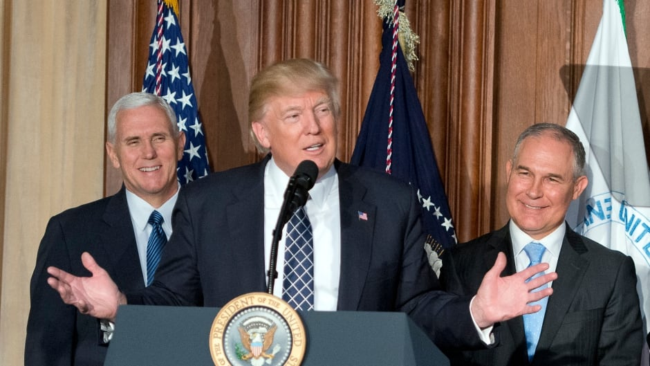 US  President Donald Trump signs an Energy Independence Executive Order at the Environmental Protection Agency (EPA) Headquarters on March 28, 2017 in Washington, DC.  This week EPA Administrator Scott Pruitt (right) revoked the Clean Power Plan.