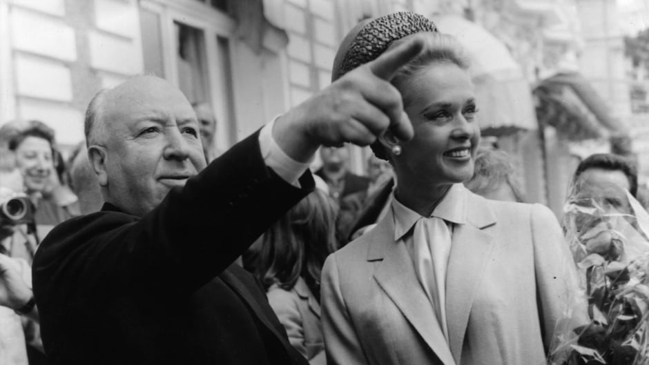 Alfred Hitchcock and Tippi Hedren explore Cannes together after the premiere of The Birds' in 1963. Hedren later published a memoir accusing the director of grabbing her.