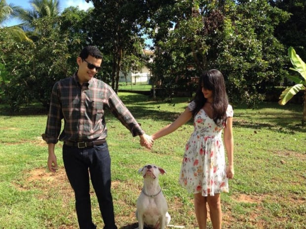 Leo Gomez with his wife and dog