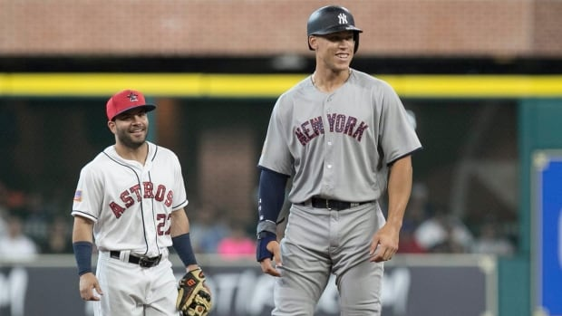 Houston's Jose Altuve, left, said New York Yankee rookie Aaron Judge, right, would have his AL MVP vote, despite both players boasting strong cases for the award.