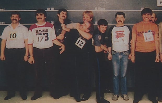 The infamous 1982 Vancouver police line-up photo of Ivan Henry in a head lock
