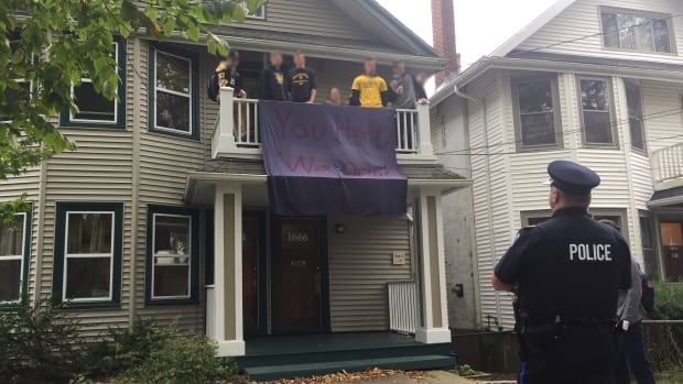 Halifax Regional Police shut down a number of parties Saturday morning and afternoon that were being held to celebrate Dalhousie University's homecoming. The banner hanging outside this house says, 'You honk we drink.'