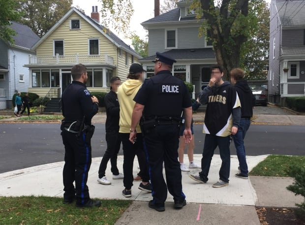 police-and-students-dal-homecoming.jpg