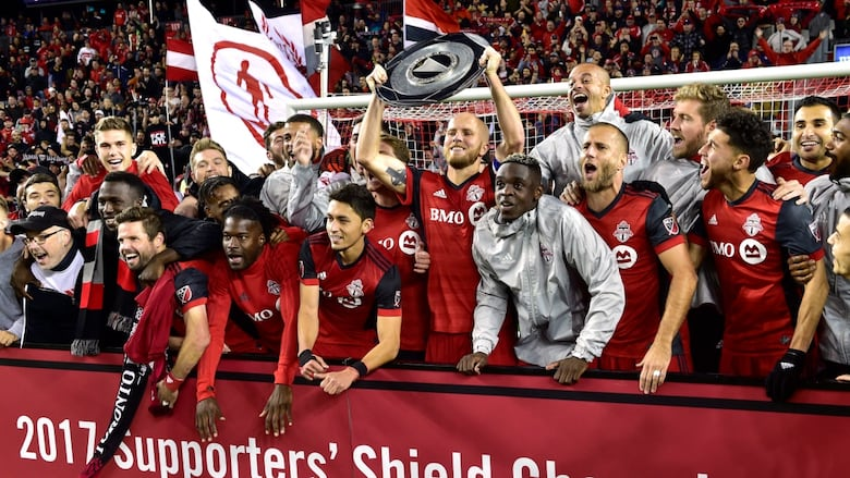 The Toronto Fc Celebrate With The Supporters Shield Following Their Win Over The Montreal Impact Frank Gunn The Canadian Press